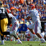 Florida Gators quarterback Austin Appleby scrambles looking downfield during the first half as the Florida Gators defeat the University of Iowa Hawkeyes 30-3 in the 2017 Outback Bowl in Tampa, Florida.  January 2nd, 2017.  Country photo by David Bowie.