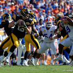 Iowa Hawkeyes quarterback C.J. Beathard rolls out of the pocker during the first half as the Florida Gators defeat the University of Iowa Hawkeyes 30-3 in the 2017 Outback Bowl in Tampa, Florida.  January 2nd, 2017.  Country photo by David Bowie.
