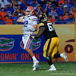 Florida Gators quarterback Austin Appleby throwing under pressure during the first half as the Florida Gators defeat the University of Iowa Hawkeyes 30-3 in the 2017 Outback Bowl in Tampa, Florida.  January 2nd, 2017.  Country photo by David Bowie.