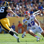 Florida Gators linebacker Cristian Garcia attempts to tackle Iowa quarterback C.J. Beathard during the first half as the Florida Gators defeat the University of Iowa Hawkeyes 30-3 in the 2017 Outback Bowl in Tampa, Florida.  January 2nd, 2017.  Country photo by David Bowie.