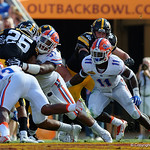 Florida Gators defensive lineman Caleb Brantley with a tackle during the first half as the Florida Gators defeat the University of Iowa Hawkeyes 30-3 in the 2017 Outback Bowl in Tampa, Florida.  January 2nd, 2017.  Country photo by David Bowie.