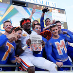 Florida Gators wide receiver Ahmad Fulwood leaps into the stands as the Florida Gators celebrate defeating the University of Iowa Hawkeyes 30-3 in the 2017 Outback Bowl in Tampa, Florida.  January 2nd, 2017.  Country photo by David Bowie.
