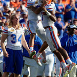 Florida Gators linebacker Daniel McMillian and Florida Gators defensive back Teez Tabor celebrate after McMillian's interception during the second half as the Florida Gators defeat the University of Iowa Hawkeyes 30-3 in the 2017 Outback Bowl in Tampa, Florida.  January 2nd, 2017.  Country photo by David Bowie.