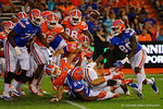 The ball flies up into the air as Florida Gators running back Mark Thompson fumbles the ball, as the University of Florida Gators fotball team scrimmages for the final time this spring in the annual Orange and Blue Debut at Ben Hill Griffin Stadium.  April 8th, 2016.  Gator Country Photo by David Bowie.