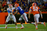 Florida Gators quarterback Luke Del Rio hands the ball off to Florida Gators running back Mark Thompson, as the University of Florida Gators fotball team scrimmages for the final time this spring in the annual Orange and Blue Debut at Ben Hill Griffin Stadium.  April 8th, 2016.  Gator Country Photo by David Bowie.