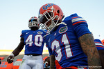 Florida Gators defensive back Jalen Tabor and Florida Gators linebacker Jarrad Davis get pumped up as they get set to take the field, as the University of Florida Gators fotball team scrimmages for the final time this spring in the annual Orange and Blue Debut at Ben Hill Griffin Stadium.  April 8th, 2016.  Gator Country Photo by David Bowie.