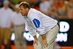 Florida Gators head coach Jim McElwain watches on as the University of Florida Gators fotball team scrimmages for the final time this spring in the annual Orange and Blue Debut at Ben Hill Griffin Stadium.  April 8th, 2016.  Gator Country Photo by David Bowie.
