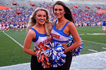 Two Florida Gators cheerleaders pose for the camera as the University of Florida Gators fotball team scrimmages for the final time this spring in the annual Orange and Blue Debut at Ben Hill Griffin Stadium.  April 8th, 2016.  Gator Country Photo by David Bowie.