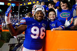 Florida Gators defensive lineman Cece Jefferson poses with a young Gator fan, as the University of Florida Gators fotball team scrimmages for the final time this spring in the annual Orange and Blue Debut at Ben Hill Griffin Stadium.  April 8th, 2016.  Gator Country Photo by David Bowie.