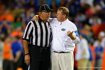 Florida Gators head coach Jim McElwain talking with one of the referees, as the University of Florida Gators fotball team scrimmages for the final time this spring in the annual Orange and Blue Debut at Ben Hill Griffin Stadium.  April 8th, 2016.  Gator Country Photo by David Bowie.
