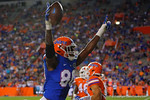 Florida Gators tight end C'yontai Lewis celebrates a touchddown, as the University of Florida Gators fotball team scrimmages for the final time this spring in the annual Orange and Blue Debut at Ben Hill Griffin Stadium.  April 8th, 2016.  Gator Country Photo by David Bowie.