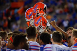 The Gators hold their helmets into the air, as the University of Florida Gators fotball team scrimmages for the final time this spring in the annual Orange and Blue Debut at Ben Hill Griffin Stadium.  April 8th, 2016.  Gator Country Photo by David Bowie.