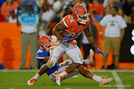 Florida Gators defensive back Chris Williamson makes the tackle on Florida Gators running back Jordan Scarlett, as the University of Florida Gators fotball team scrimmages for the final time this spring in the annual Orange and Blue Debut at Ben Hill Griffin Stadium.  April 8th, 2016.  Gator Country Photo by David Bowie.