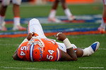 Florida Gators defensive lineman Khairi Clark lies on the ground hurt after a play, as the University of Florida Gators fotball team scrimmages for the final time this spring in the annual Orange and Blue Debut at Ben Hill Griffin Stadium.  April 8th, 2016.  Gator Country Photo by David Bowie.
