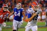 Florida Gators quarterback Feleipe Franks scrambles downfield for a first down, as the University of Florida Gators fotball team scrimmages for the final time this spring in the annual Orange and Blue Debut at Ben Hill Griffin Stadium.  April 8th, 2016.  Gator Country Photo by David Bowie.