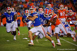 Florida Gators wide receiver C.J. Worton picks up the fuble by Florida Gators running back Mark Thompson and rushes it into the endzone for a touchdown, as the University of Florida Gators fotball team scrimmages for the final time this spring in the annual Orange and Blue Debut at Ben Hill Griffin Stadium.  April 8th, 2016.  Gator Country Photo by David Bowie.