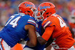 Florida Gators offensive lineman Fred Johnson and Florida Gators defensive lineman Jordan Smith collide as the University of Florida Gators fotball team scrimmages for the final time this spring in the annual Orange and Blue Debut at Ben Hill Griffin Stadium.  April 8th, 2016.  Gator Country Photo by David Bowie.
