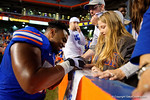 Florida Gators defensive lineman Caleb Brantley signing autographs for the fans, as the University of Florida Gators fotball team scrimmages for the final time this spring in the annual Orange and Blue Debut at Ben Hill Griffin Stadium.  April 8th, 2016.  Gator Country Photo by David Bowie.
