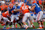 Florida Gators running back Mark Thompson runs into the Orange defense, as the University of Florida Gators fotball team scrimmages for the final time this spring in the annual Orange and Blue Debut at Ben Hill Griffin Stadium.  April 8th, 2016.  Gator Country Photo by David Bowie.