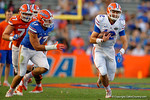 Florida Gators quarterback Austin Appleby scrambles downfield, as the University of Florida Gators fotball team scrimmages for the final time this spring in the annual Orange and Blue Debut at Ben Hill Griffin Stadium.  April 8th, 2016.  Gator Country Photo by David Bowie.