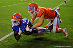 Florida Gators tight end C'yontai Lewis dives past Florida Gators defensive back Mark Norvelis for the catch and the touchdown, as the University of Florida Gators fotball team scrimmages for the final time this spring in the annual Orange and Blue Debut at Ben Hill Griffin Stadium.  April 8th, 2016.  Gator Country Photo by David Bowie.