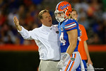 Florida Gators head coach Jim McElwain and Florida Gators linebacker Alex Anzalone share a moment, as the University of Florida Gators fotball team scrimmages for the final time this spring in the annual Orange and Blue Debut at Ben Hill Griffin Stadium.  April 8th, 2016.  Gator Country Photo by David Bowie.