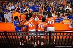 Florida Gators linebacker David Reese,Florida Gators linebacker Darius Singletary,Florida Gators wide receiver Isaac O'Neal and Florida Gators defensive lineman Taven Bryan signing autographs for the fans, as the University of Florida Gators fotball team scrimmages for the final time this spring in the annual Orange and Blue Debut at Ben Hill Griffin Stadium.  April 8th, 2016.  Gator Country Photo by David Bowie.