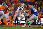 Florida Gators quarterback Kyle Trask scrambling as the University of Florida Gators fotball team scrimmages for the final time this spring in the annual Orange and Blue Debut at Ben Hill Griffin Stadium.  April 8th, 2016.  Gator Country Photo by David Bowie.