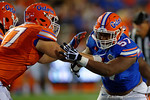 Florida Gators defensive lineman Caleb Brantley rushes upfield trying to get by the block by Florida Gators offensive lineman Andrew Mike, as the University of Florida Gators fotball team scrimmages for the final time this spring in the annual Orange and Blue Debut at Ben Hill Griffin Stadium.  April 8th, 2016.  Gator Country Photo by David Bowie.