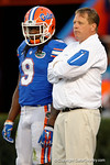 Florida Gators head coach Jim McElwain and Florida Gators wide receiver Dre Massey watching on, as the University of Florida Gators fotball team scrimmages for the final time this spring in the annual Orange and Blue Debut at Ben Hill Griffin Stadium.  April 8th, 2016.  Gator Country Photo by David Bowie.
