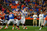 Florida Gators quarterback Feleipe Franks throws downfield as Florida Gators head coach Jim McElwain watches on from behind, as the University of Florida Gators fotball team scrimmages for the final time this spring in the annual Orange and Blue Debut at Ben Hill Griffin Stadium.  April 8th, 2016.  Gator Country Photo by David Bowie.