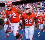Florida Gators offensive lineman Stone Forsythe and Florida Gators defensive lineman Jabari Zuniga take the field, as the University of Florida Gators fotball team scrimmages for the final time this spring in the annual Orange and Blue Debut at Ben Hill Griffin Stadium.  April 8th, 2016.  Gator Country Photo by David Bowie.