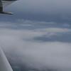Broken Clouds below, storm off to the East.