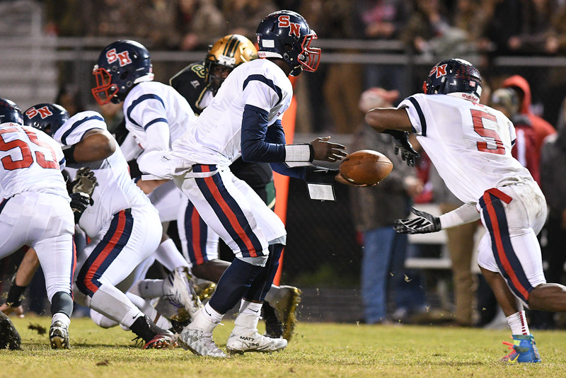 """Southern Nash Matt """"toonice"""" hampton (1) Southern Nash Dae'one Wilkins (5) during tonights game.Southern Nash defeats Northern Nash 28-11 Thursday evening November 10, 2016 in Rocky Mount, NC (Photos by Anthony Barham / WRAL contributor.)"""