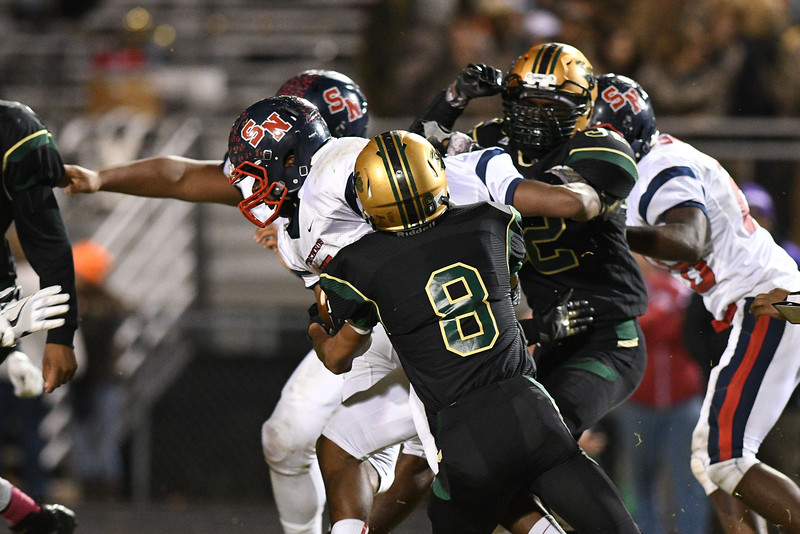 Northern Nash Austin Evans (8) Southern Nash Dae'one Wilkins (5) during tonights game.Southern Nash defeats Northern Nash 28-11 Thursday evening November 10, 2016 in Rocky Mount, NC (Photos by Anthony Barham / WRAL contributor.)