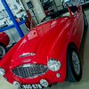 Red Austin Healy - front view