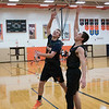 161129 Wilson Boys 2 - Steve Lewis puts the ball up as he and Justin Daul go one on one during practice.