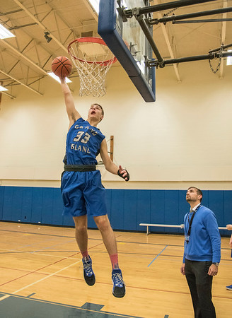 James Neiss/staff photographer <br /> Grand Island, NY - Grand Island boys basketball player Liam Carey puts the ball up during practice.