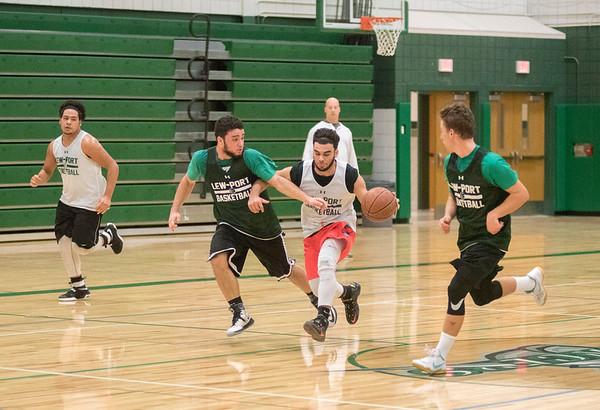 James Neiss/staff photographer <br /> Lewiston, NY - Lewiston- Porter basketball player Will Duff drives the ball during practice.
