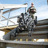 160928 Robots 1<br /> James Neiss/staff photographer <br /> Cheektowaga, NY - Capt. Jim Welch with the Erie County Sheriff's Department demonstrates the stair climbing ability of his ICOR Technology Mini-CALIBER SWAT Robot.