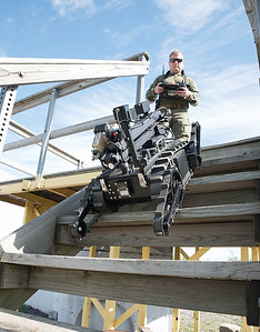 160928 Robots 1 James Neiss/staff photographer  Cheektowaga, NY - Capt. Jim Welch with the Erie County Sheriff's Department demonstrates the stair climbing ability of his ICOR Technology Mini-CALIBER SWAT Robot.