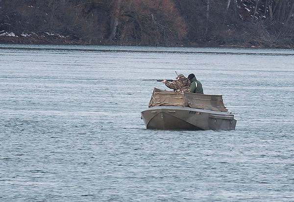160101 Hunting Enterprise 1<br /> James Neiss/staff photographer<br /> Niagara Falls, NY - Duck hunters take aim just off Lewiston Landing in Lewiston.