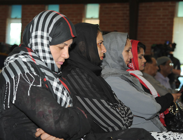 160614 - Muslim service 4 -Area Muslims pray during a service at the Masjid Mahdi, on Colvin Boulevard, Niagara Falls, to remember those who died in Orlando.<br /> Photo by: Dan Cappellazzo