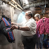 James Neiss/staff photographer <br /> Niagara Falls, NY - Russ Petrozzi owner of Capital Cleaners and supervisor Margo Fritton steam clean coats that will be available during the Coats For Kids event this Saturday from 10 a.m. to 2 p.m.