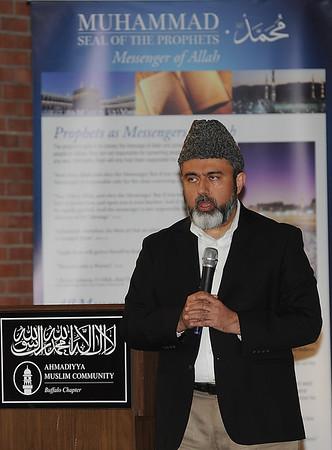 160614 - Muslim service - Dr. Nasir Khan, President of the Buffalo Chapter Ahmadiyya Muslim Community speaks during a service at the Masjid Mahdi, on Colvin Boulevard, Niagara Falls.<br /> Photo by: Dan Cappellazzo