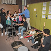 161003 Music Is Art 3<br /> James Neiss/staff photographer <br /> Niagara Falls, NY - Harry F. Abate Elementary band teacher Michael Kineke is swarmed by students wanting to check out the instruments donated by the Music Is Art program.
