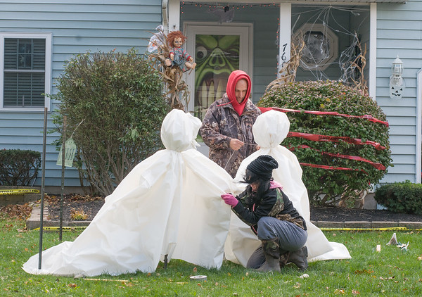 Chuck Van Epps and Michelle Mobus make a ghost circle around a campfire in front of the house on Mary Lane in Lewiston.