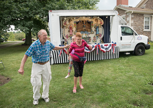 Cletus Kraft of East Amherst takes his date Erma Haight for a twirl as Patricia Haight, from Barker, takes it all in.