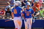 Florida Gators outfielder Amanda Lorenz pats Florida Gators outfielder Justine McLean on the head after McLean scored to put the Gators up 11-1 as the #1 ranked Florida Gators softball team defeats the Illinois State Redbords 11-1 at Katie Seashole Pressly Softball Stadium.  March 6th, 2016. Gator Country photo by David Bowie.
