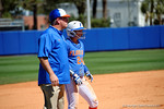 Florida Gators outfielder Kirsti Merritt ands Florida Gators softball head coach Tim Walton at third base as the #1 ranked Florida Gators softball team defeats the Illinois State Redbords 11-1 at Katie Seashole Pressly Softball Stadium.  March 6th, 2016. Gator Country photo by David Bowie.